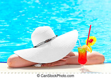 girl in the pool with a cocktail under the bonnet