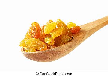 Sultana raisins on wooden spoon