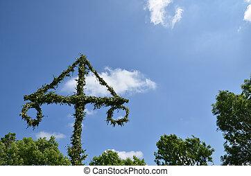 Midsummer pole at sky - Midsummer pole at green trees and...