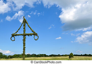 Midsummer pole - A swedish midsummer pole at blue sky,...