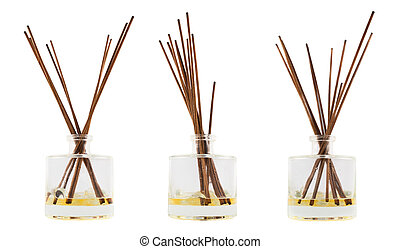 Aroma sticks in a glass flask isolated - Wooden aroma sticks...