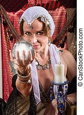 Grinning Fortune Teller - Grinning female fortune teller...