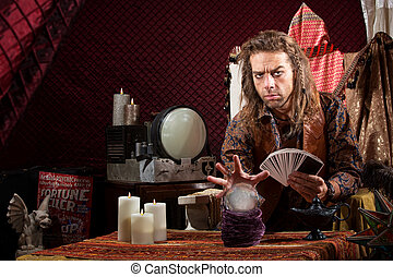 Man with Tarot Cards - Male fortune teller with tarot cards...