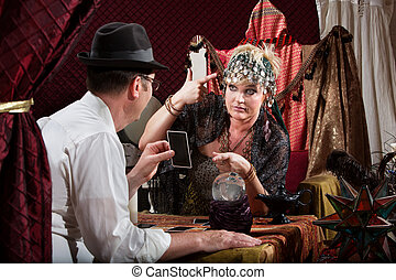 Lady Gesturing Bad Luck - Fortune teller gesturing a gun to...