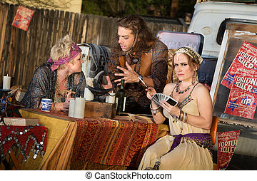 Fortune Telling Outdoor Kiosk - Group of gypsies outside...