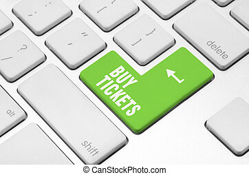 Buy tickets on the computer keyboard - Business concept: Buy...