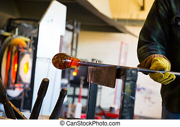 Expert Glassblower - A very talented glassblower is forming...