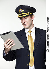 Young man in the form of a passenger plane pilot - Portrait...