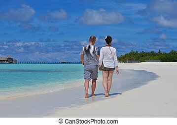 happy young couple at summer vacation have fun and relax at...