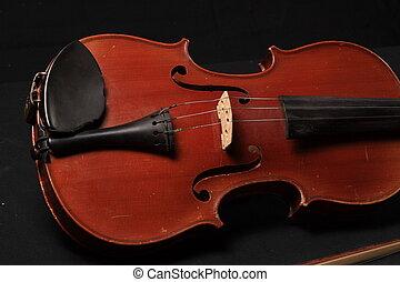 Violin on black background
