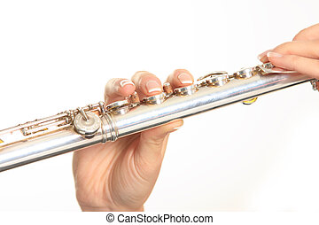 playing transverse flute - woman playing transverse flute on...