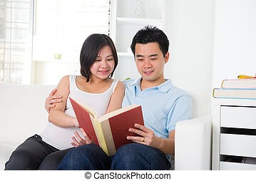 asian chinese pregnant couple reading
