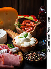 Antipasto and catering platter with different meat and...