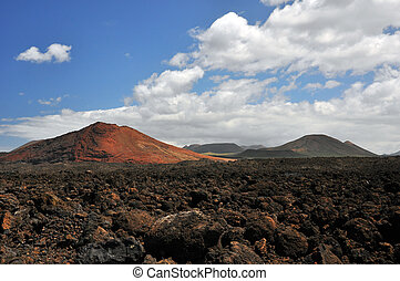 Lanzarote, its volcanoes and stone fields of clinker