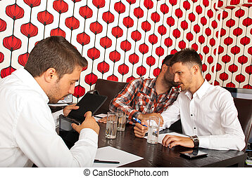 Secrets men at business meeting - Man telling a secret to...