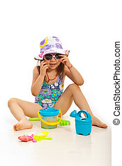 Funny girl with beach toys - Funny girl with hat and...