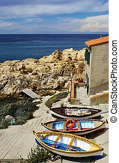 Small fishing boats in a cove of the Elba Island, Italy
