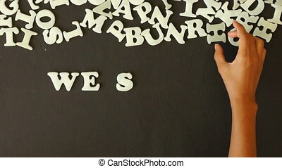 We shape Your Ideas - A person spelling We shape Your Ideas...