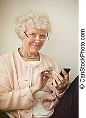 Old Lady Using Her Cellphone to Text - Old lady texting...