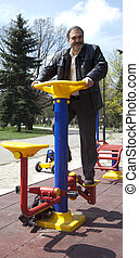 Adult man fitness exercise park