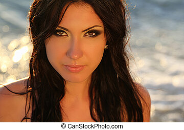 Summer portrait of beautiful woman face at sunset, ocean...