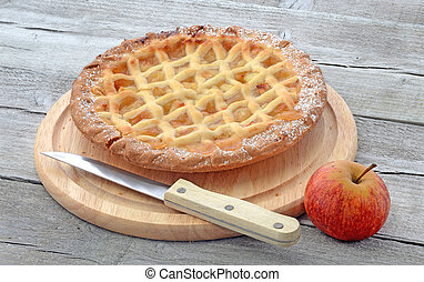 Aplle pie on cutting board - Apple pie on a cutting board...