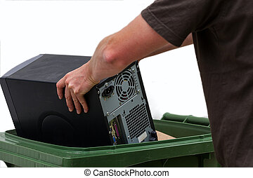 Computer recycling - Men put damaged hardware into bin