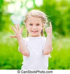 Beautiful blond little girl showing six fingers her age and...