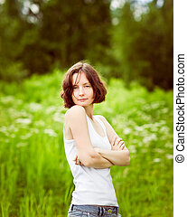 Beautiful freckled young woman with folded arms