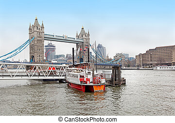 Thames river boat - Small boat on Thames river with Tower...