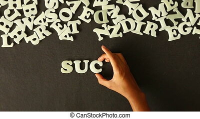 Success Strategy - A person spelling Success Strategy with...