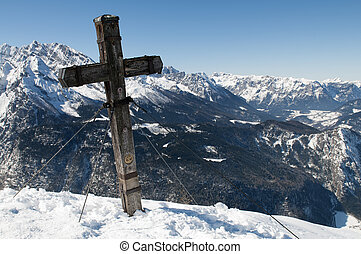 Summit Cross on Jenner Mountain with view to Watzmann in...