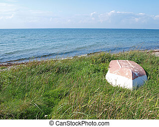 Beach landscape -Skiff boat on the grass - Beach landscape -...
