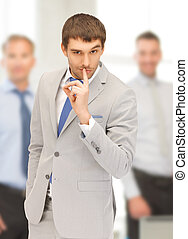 finger on lips - bright picture of handsome man with finger...