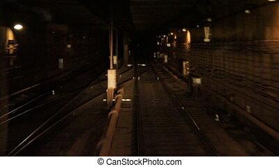 u042Bubway tunnel - Train goes through a subway tunnel