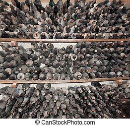 Old dusty wine bottles - Dusty wine bottles in storage.