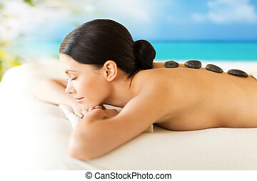 woman in spa with hot stones - picture of woman in spa salon...