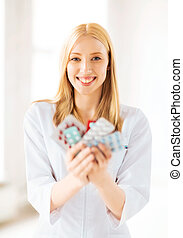 young female doctor with pack of pills - picture of young...