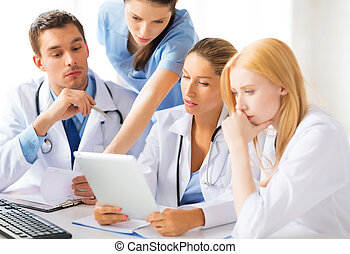 team or group of doctors working - picture of young team or...