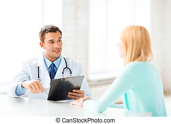 male doctor with patient - bright picture of male doctor...