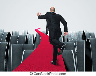 business challenge - man run on 3d red carpet abstract...