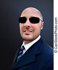 Man in elegant suit and sunglasses