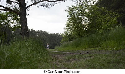Young woman runs through forest
