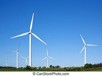 Wind Turbines Against Blue Sky - Wind turbines generating...