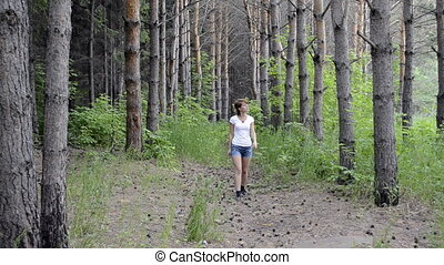 Young woman lost in the pine forest