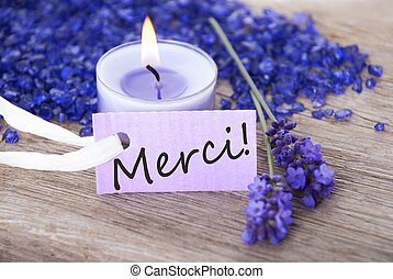 purple label with merci - a purple label with the french...