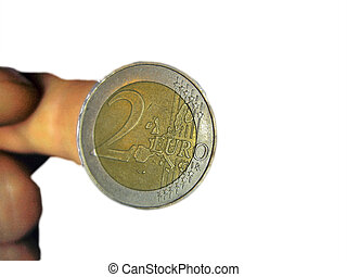 Two euro coin on the male fingers isolated