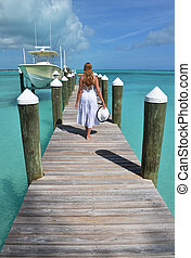 Girl on the yacht pier. Exuma, Bahamas