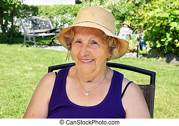 Senior woman with hat