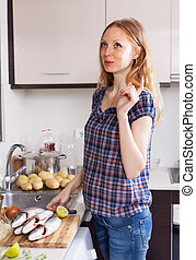 woman is thinking what to cook fish